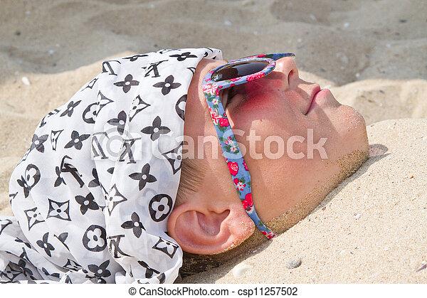Boy buried in sand - csp11257502