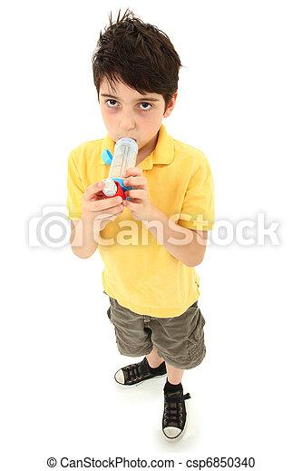 Boy Child Using Asthma Inhaler with Spacer Chamber - csp6850340