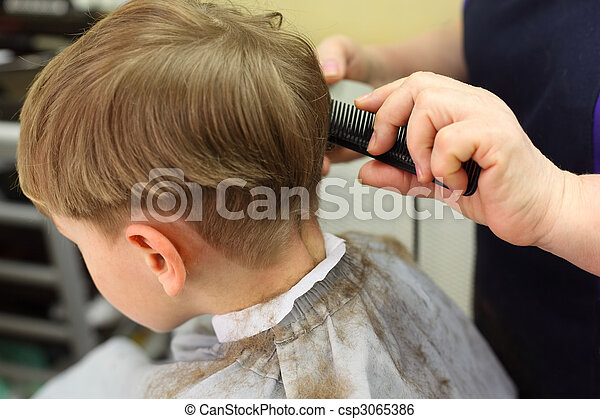 Boy cut in  hairdressing salon - csp3065386