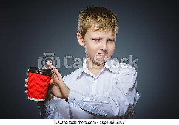 boy does not want to drink coffee. The child does not like the beverage - csp48686207