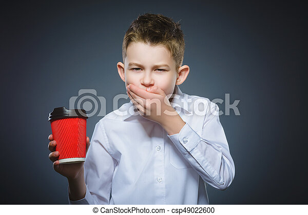 boy does not want to drink coffee. The child does not like the beverage - csp49022600