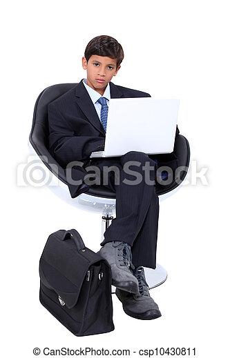 Boy dressed as a businessman - csp10430811