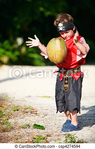 Boy dressed as pirate with coconut - csp4274594