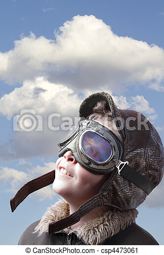 Boy dressed up in pilot?s outfit, jacket, hat and glasses. - csp4473061