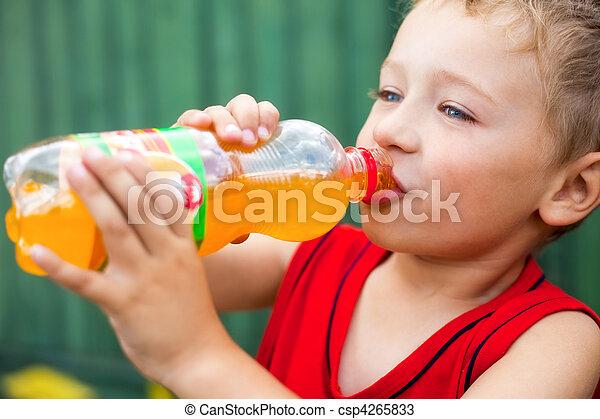 Boy drinking unhealthy bottled soda - csp4265833