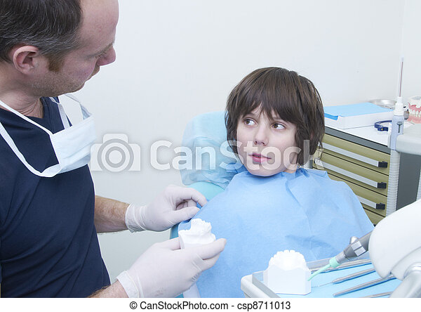 boy during a dental visit. doctor's clinic - csp8711013