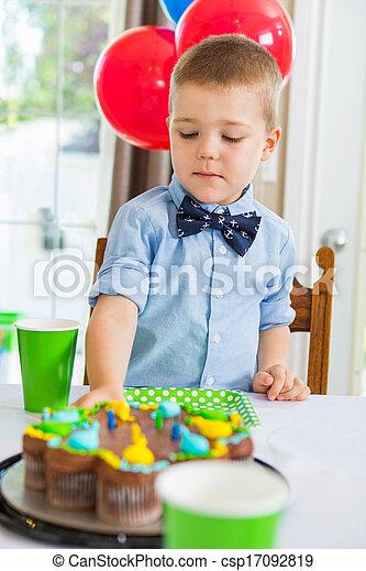 Boy Eating Birthday Cake - csp17092819