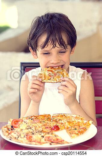 boy eating pizza - csp20114554