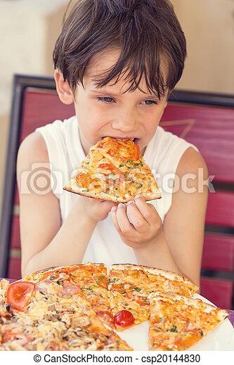 boy eating pizza - csp20144830