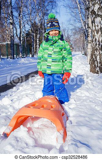 Christmas Vacation Sled.Boy Enjoying A Sleigh Ride