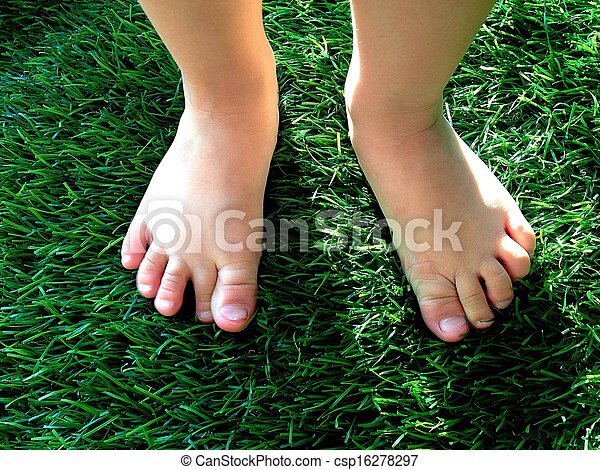 Boy Feet On Grass