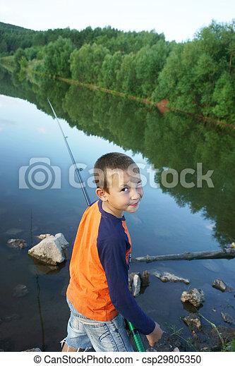 boy fishing on the lake - csp29805350