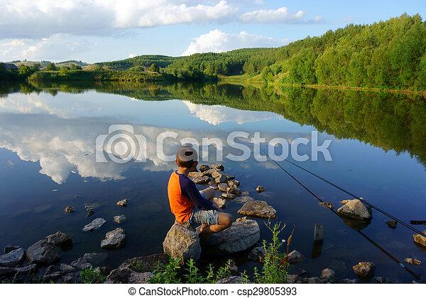 boy fishing on the lake - csp29805393