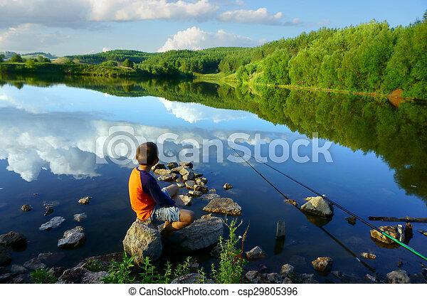 boy fishing on the lake - csp29805396