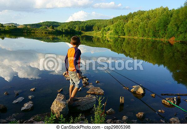 boy fishing on the lake - csp29805398