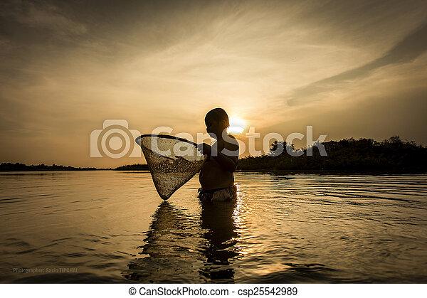Boy fishing on the river. - csp25542989