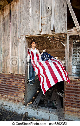 Boy hanging American flag - csp6892351