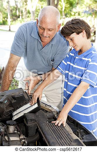 Boy Helps Dad - csp5612617