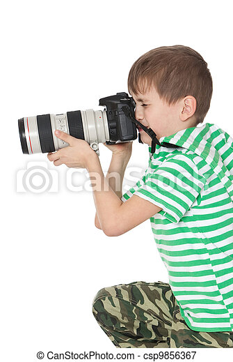 Boy holding a camera - csp9856367