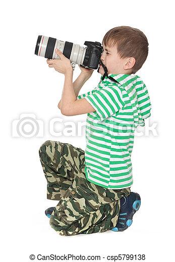 Boy holding a camera - csp5799138