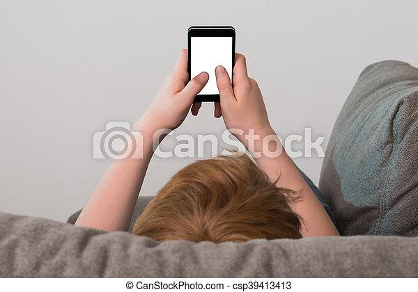 Boy Holding Cellphone - csp39413413