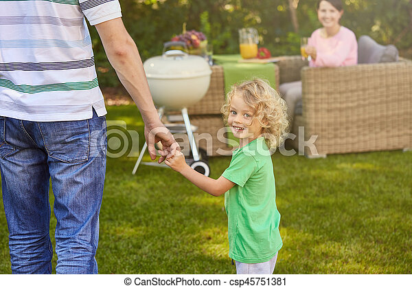Boy holding father's hand - csp45751381