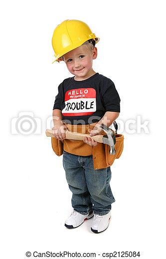Boy Holding Hammer Wearing Toolbelt and Hard Hat - csp2125084