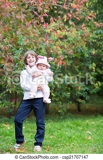 Boy holding his baby sister - csp21707147