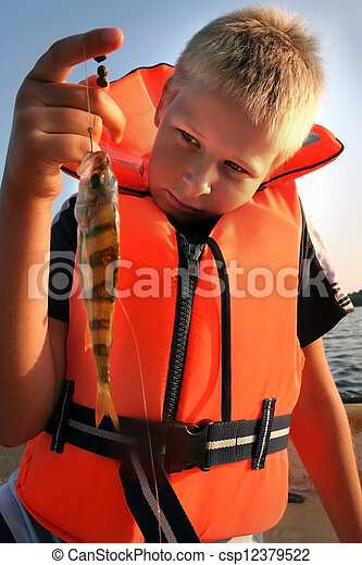 boy holding his catch of the day - csp12379522