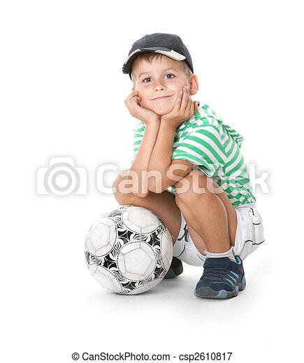 Boy holding soccer ball - csp2610817