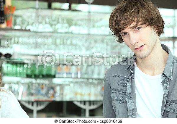boy in a bar - csp8810469