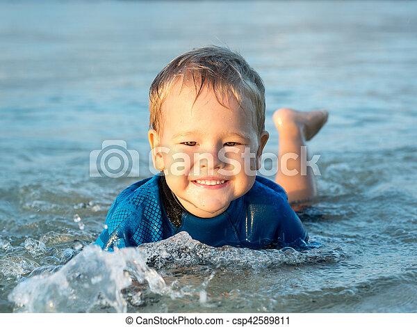 Boy in a sea - csp42589811
