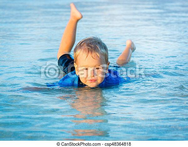 Boy in a sea - csp48364818
