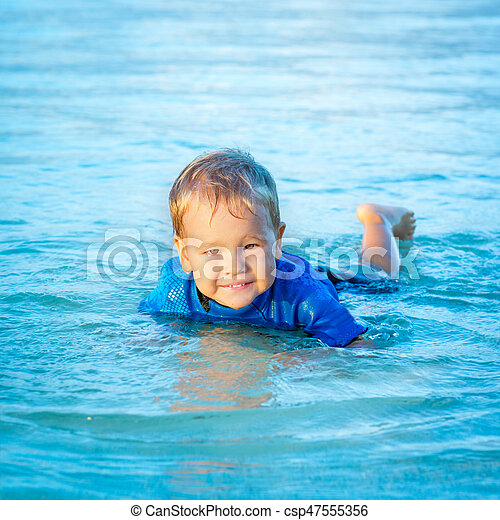 Boy in a sea - csp47555356