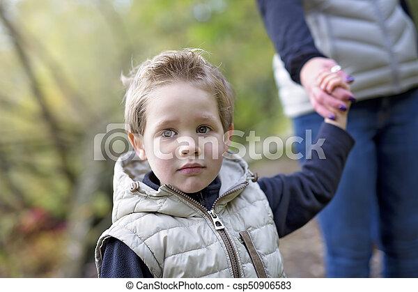 boy in autumn season in a park - csp50906583