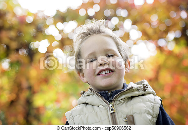boy in autumn season in a park - csp50906562