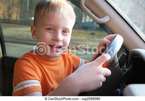 boy in car - csp2596989