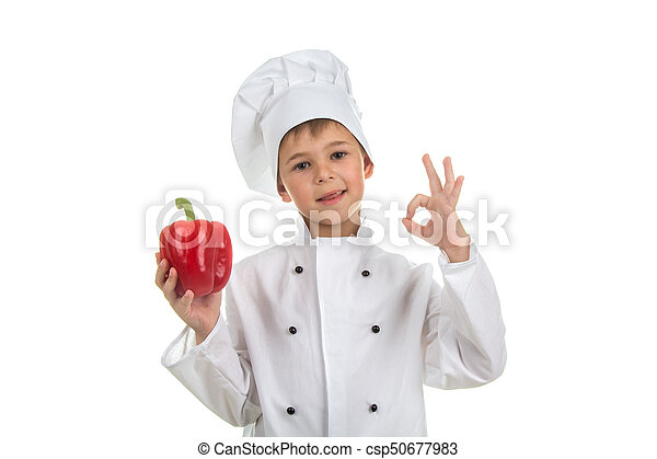 5f00a33e13 Boy in chef uniform making ok gesture and holding red pepper - csp50677983