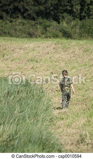 Boy in field - csp0010594