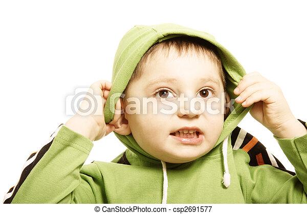 Boy in green putting on hood - csp2691577