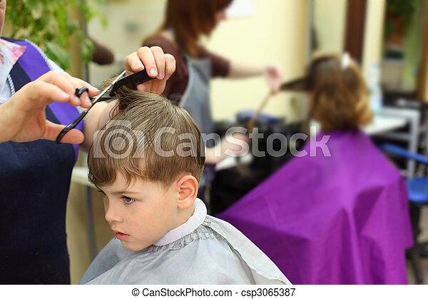 Boy in hairdressing salon - csp3065387