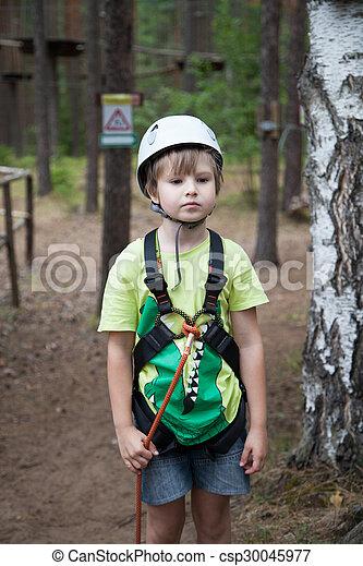 Boy in helmet and travel gear - csp30045977