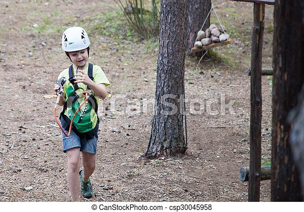 Boy in helmet and travel gear - csp30045958