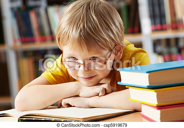 Boy in library  - csp5919679