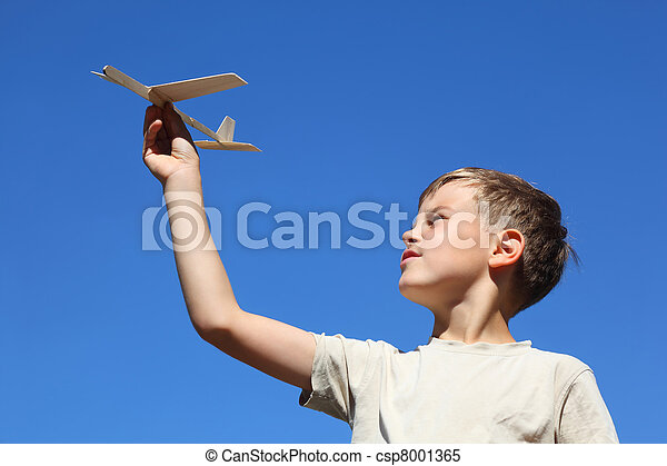 Boy in summer plays with  home-made model of airplane - csp8001365