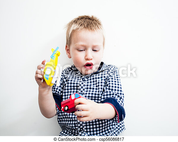 Boy is lying on the floor with toys - csp56086817