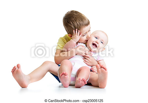 Boy kissing his little sister baby isolated on white - csp23005125