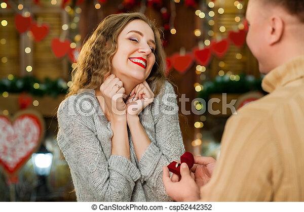 boy making marrige propose to girl - csp52442352