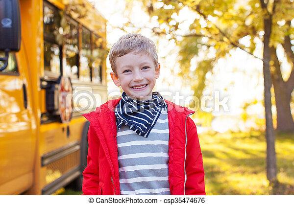 boy near schoolbus - csp35474676