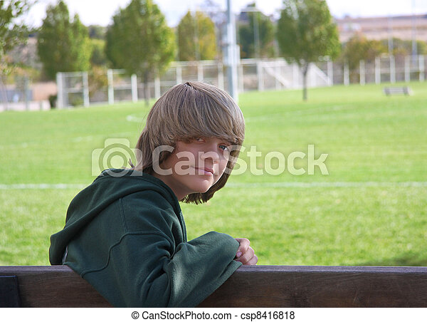 Boy On Bench Young Teen Boy With Long Shaggy Hair